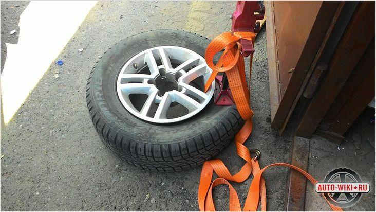 Разбортировка колеса реечным домкратом